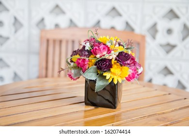 a photo of decorate flower on wooden table