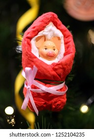 Photo decoration bright funny toy on the Christmas tree a pig for the New Year.