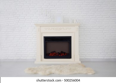 photo of Decorative fireplace in an empty apartment