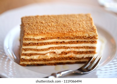 Photo of a delicious macro cake with honey in a restaurant