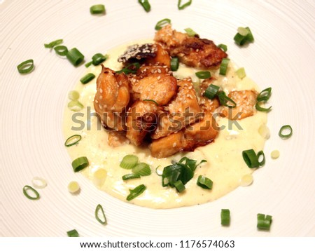 Photo of delicious macro slices of salmon with spinach in sauce