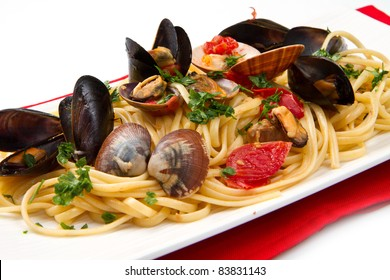 photo of delicious pasta with clams and mussel