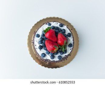 photo of delicious tasty cake with fresh strawberries and blueberries on the wonderful white background