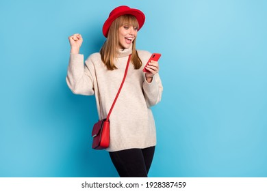 Photo of delighted attractive person fist up open mouth celebrate new comment follow isolated on blue color background