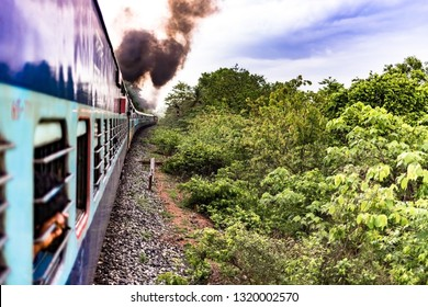 Photo depicting that Journey is more beautiful than the Destination. The photo is taken in rainy season of monsoons while travelling in the iconic Goa Express of Indian Railways being ran on Diesel.