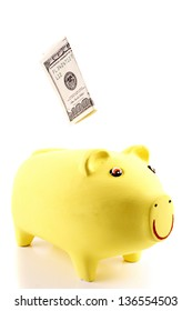 Photo of Depositing in Piggy bank