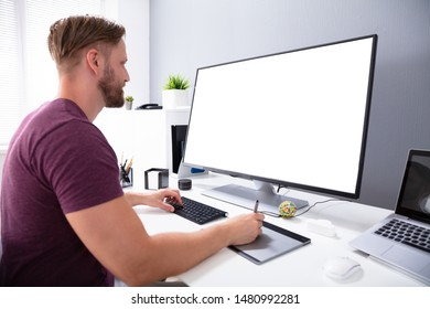 Photo Of Designer Working On Computer In Office