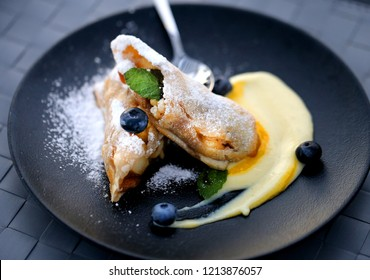 Photo of dessert apple pie with blueberry on a plate in a restaurant