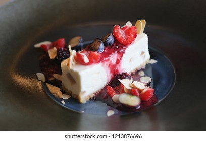 Photo of dessert cheesecake with berries in a restaurant