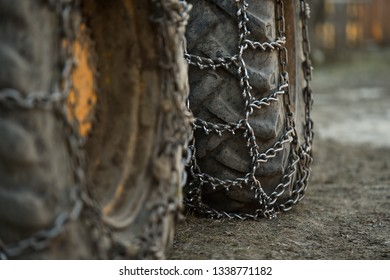 Photo detail with snow tire chains on big truck wheel