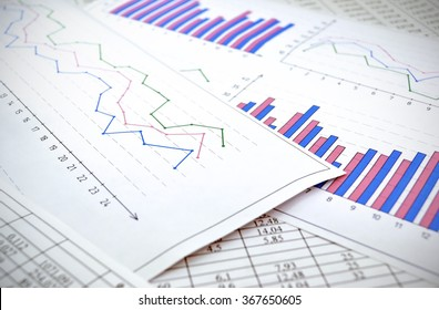 Photo diagrams graphs and numerals in the table on the paper