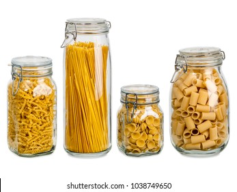 Photo of different pasta types in large glass jars over white background.