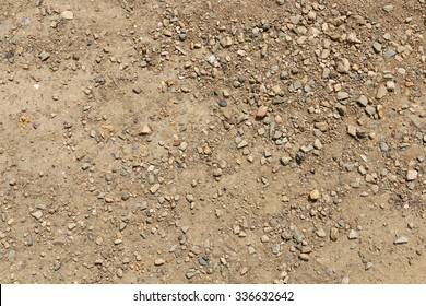 Photo of dirt and dusty road with small stones