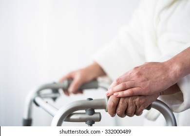 Photo of disabled old person with walking aid