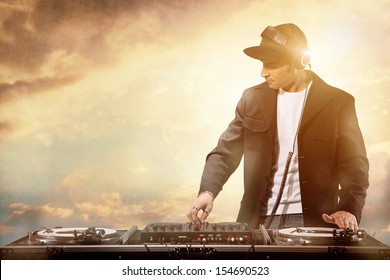 Photo of dj working at sunset