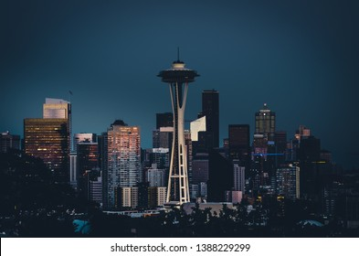 Photo of downtown Seattle during a beautiful summer evening in Washington, featuring the iconic Seattle Space Needle standing out from the skyline