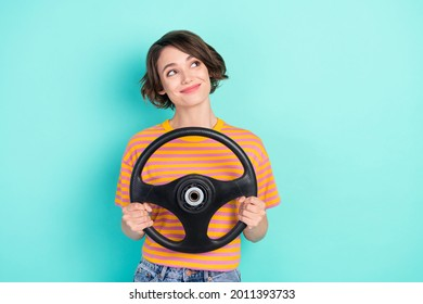 Photo of dreamy adorable woman dressed striped t-shirt smiling driving car looking empty space isolated teal color background - Shutterstock ID 2011393733