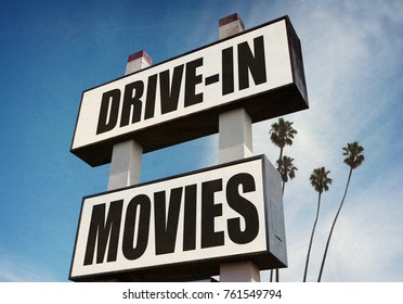 photo of drive in movies sign with palm trees