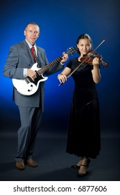 A photo of a duet - guitarist and violinist