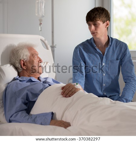 Photo of elder patient discussing diagnosis with his grandson