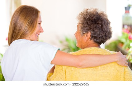 Photo of elderly woman with her daughter