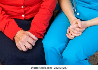 Photo of elderly woman and young carer hands