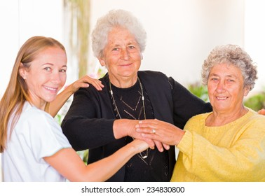 Photo of elderly women with their carer