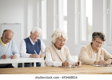 Photo of elders in white classroom during IT exam