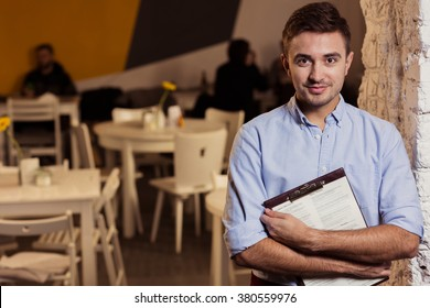 Photo of elegant small restaurant's manager at work