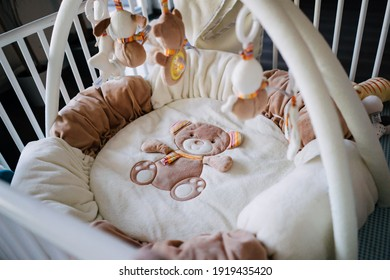 photo of an empty baby bassinet in the room