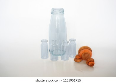 A photo of empty blue glass bottles isolated on white background