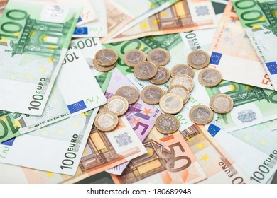 Photo Of Euro Banknotes And Coins In Abundance