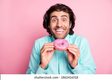 Photo of excited funny guy hold colorful donut cake taste dessert sugary addiction concept isolated pink background