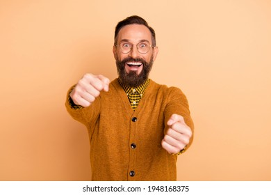 Photo of excited mature man hold hands drive imaginary car wear pullover isolated over pastel color background