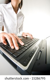 Photo of executive businesswomanâ??s hands on keyboard of laptop while typing documents