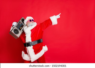 Photo of extremely ecstatic rejoice overjoyed in good mood dancing father grandfather pointing showing to the side holding cassette retro player on shoulder isolated bright background
