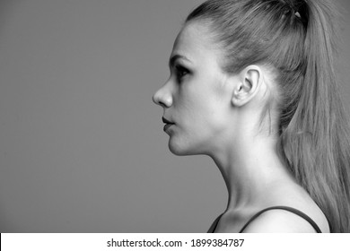 photo of the face in the profile of a young model-girl, taken in a photo studio