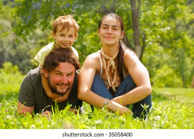 Photo of a family enjoying a summer day on a green meadow