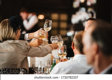 photo of a family holding up their glasses of wine