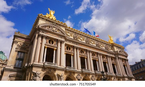 Photo from famous Palais Garnier or Opera in center of Paris with beautiful scattered clouds, France