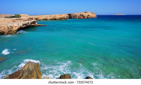 Photo of famous rocky seascape of Koufonisi island with caves and turquoise - sapphire clear waters, Cyclades, Greece