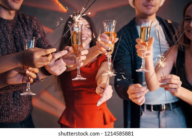 A photo featuring a group of friends who have fun with snowmen and champagne. Happy New Year. Close up