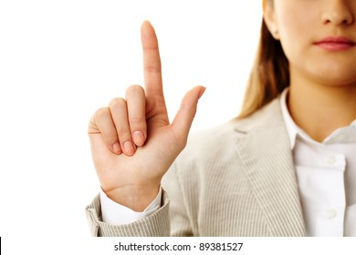 Photo of female hand with forefinger pointing upwards
