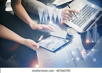 Photo female hands holding modern tablet. Risk managers working new private banking project in office. Using electronic devices. Graphics icons, worldwide stock exchanges interface. Horizontal