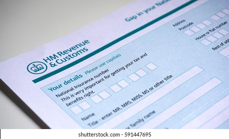 Photo of filling in a HM customs form a personal details for UK self assessment tax and benefits right.