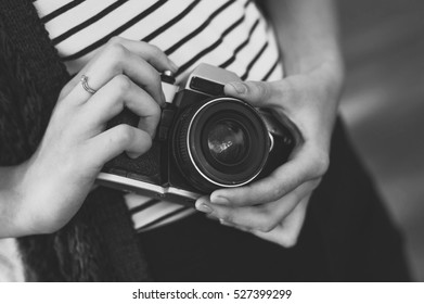 Photo film camera in the hands of the girl