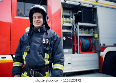 Photo of fireman in front of fire engine