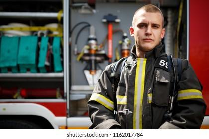 Photo of fireman near fire engine