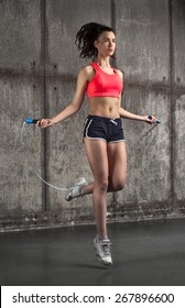 photo of fit adult girl in air