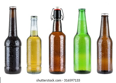 Photo of five different full beer bottles with no labels isolated on white background
